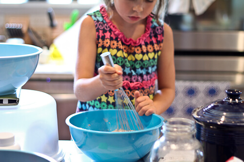 My daughter whisking the dry ingredients for muffins.