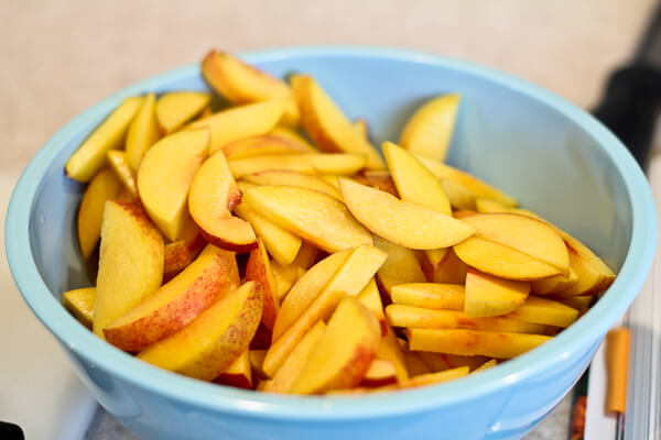 sliced underripe tart peaches for Persian beef khoresh