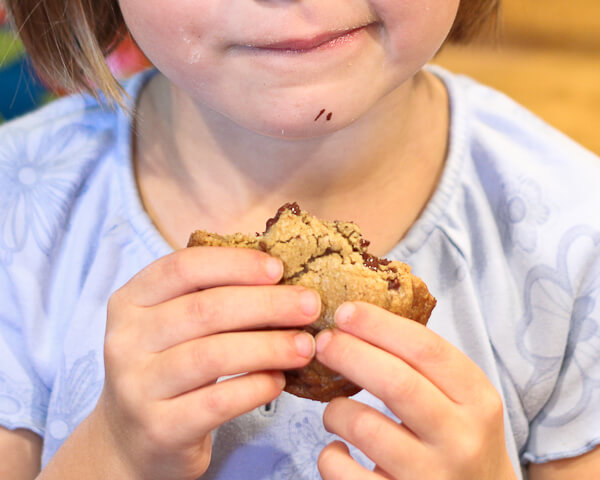 child eating browned butter chocolate chunk cookie