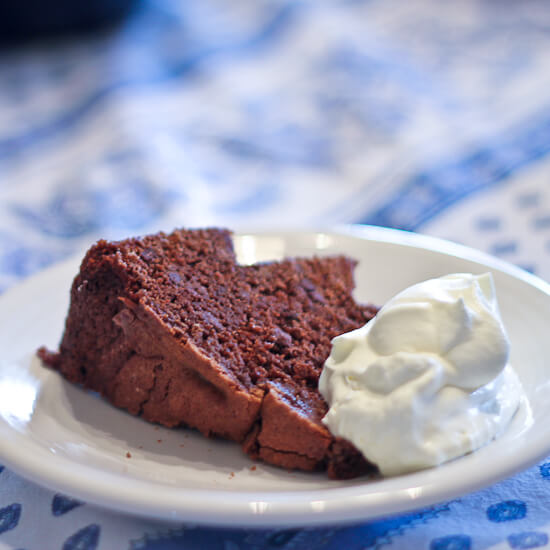A slice of Chocolate Early Grey Bundt Cake with whipped cream