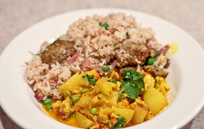 Bengali dishes with rice, meatballs, shrimp, cauliflower